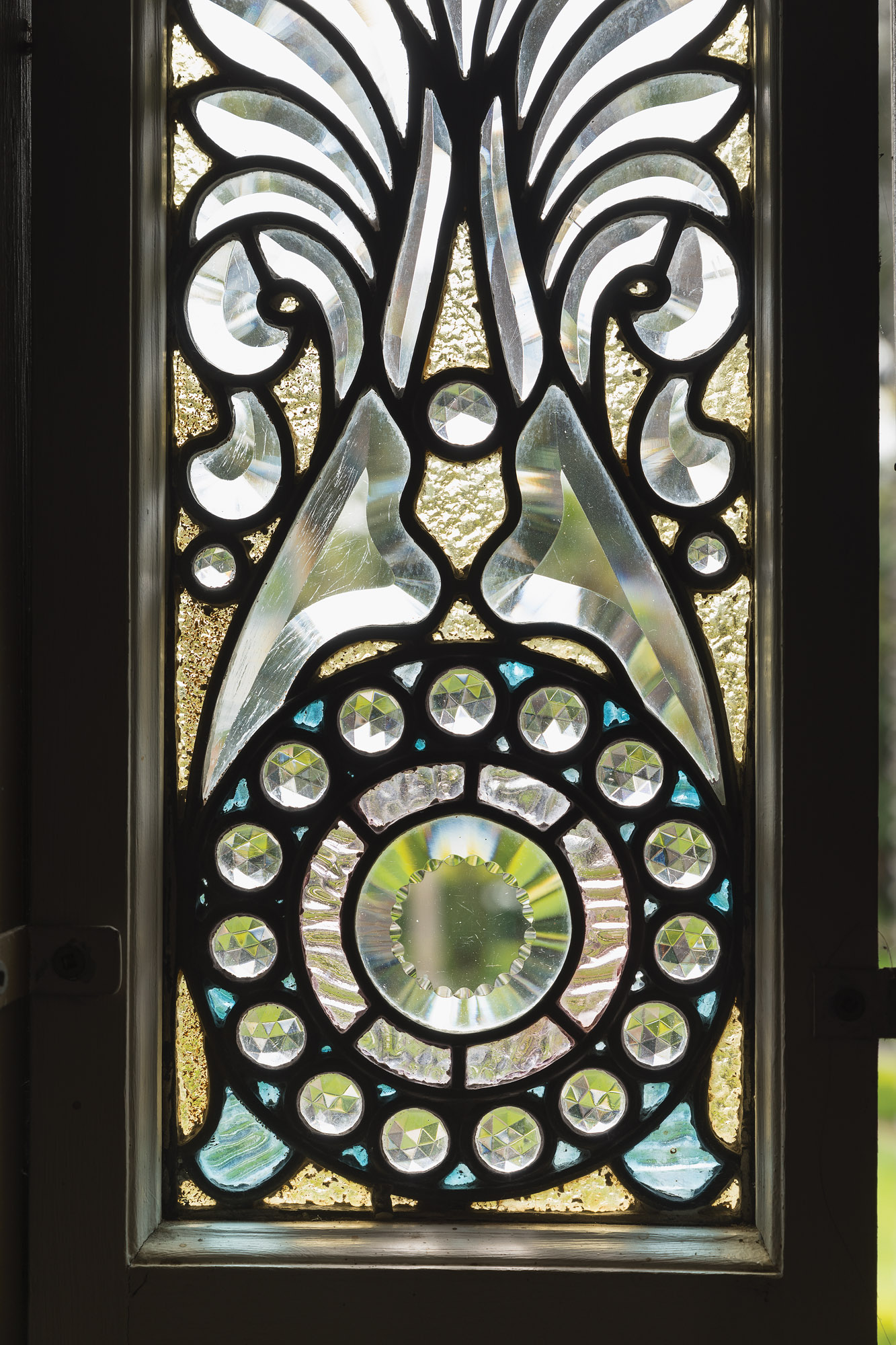 A set of three beveled-crystal windows was commissioned in 1890.