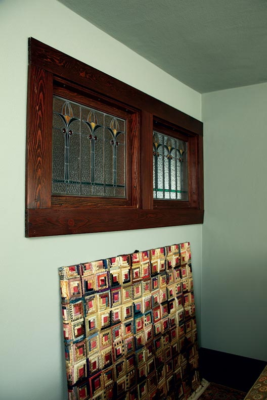 Glass artist Frank Houtkamp also made these leaded glass panels for the hallway outside a guest bedroom.