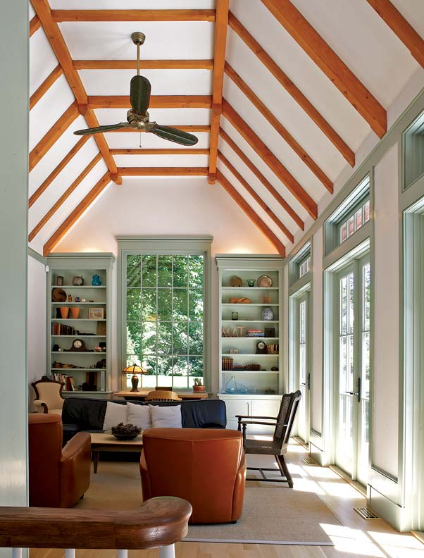 A beamed ceiling soars above the great room, which also features a wall of French doors topped by transom lights.