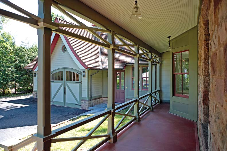 The breezeway that helps connect old to new, an extension of the home's original side porch, boasts chamfered posts and distinctive cross-braced balusters.