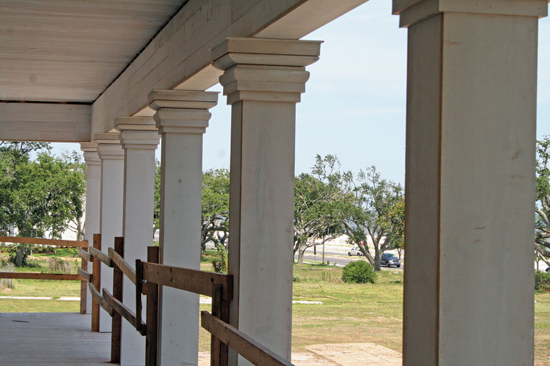 Historic photos guided the rebuilding of the stacked-wood column capitals, similar to those on other 1850s houses in the area.