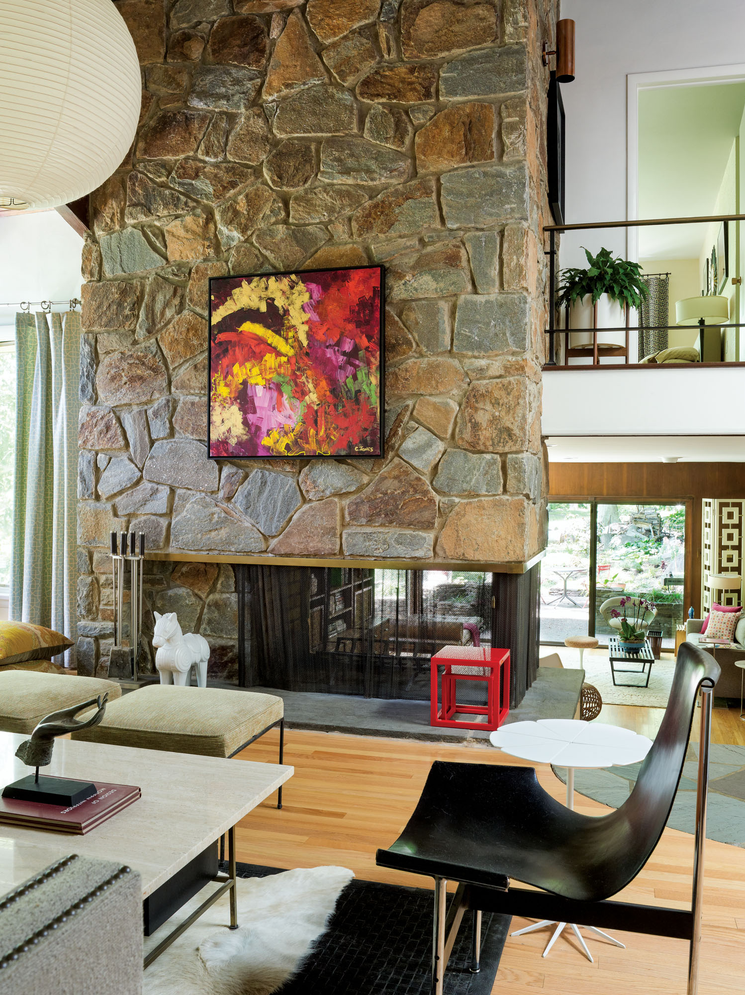 Floating fireplace with stone wall in a 1959 tri-level, Delaware.