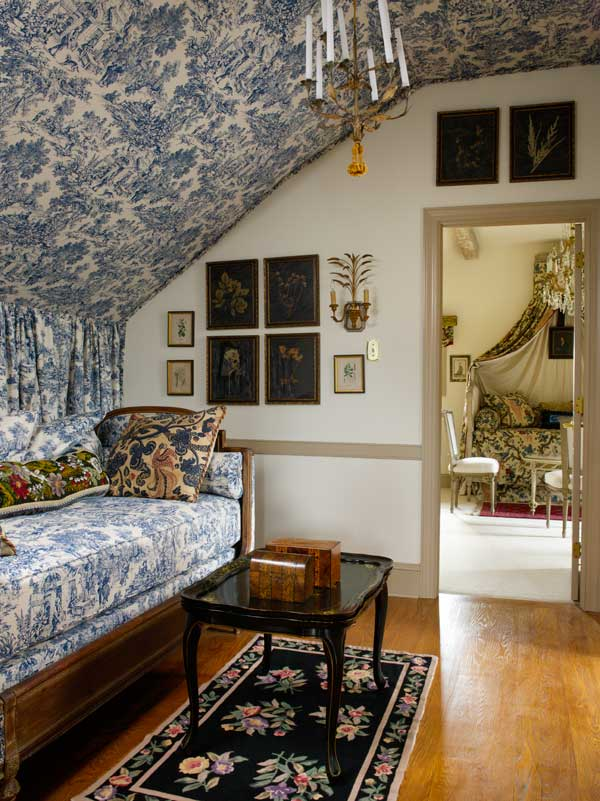 Guest rooms in the eaves are right out of the French stylebooks.