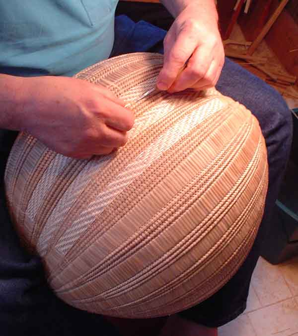 Guild member Aaron Yakim demonstrates the art of making a split white-oak basket.