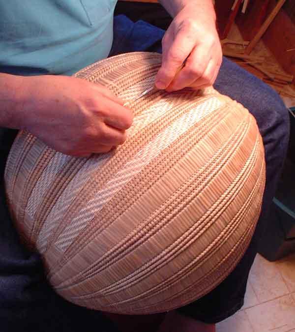 Guild member Aaron Yakim demonstrates the art of making a split white-oak basket.