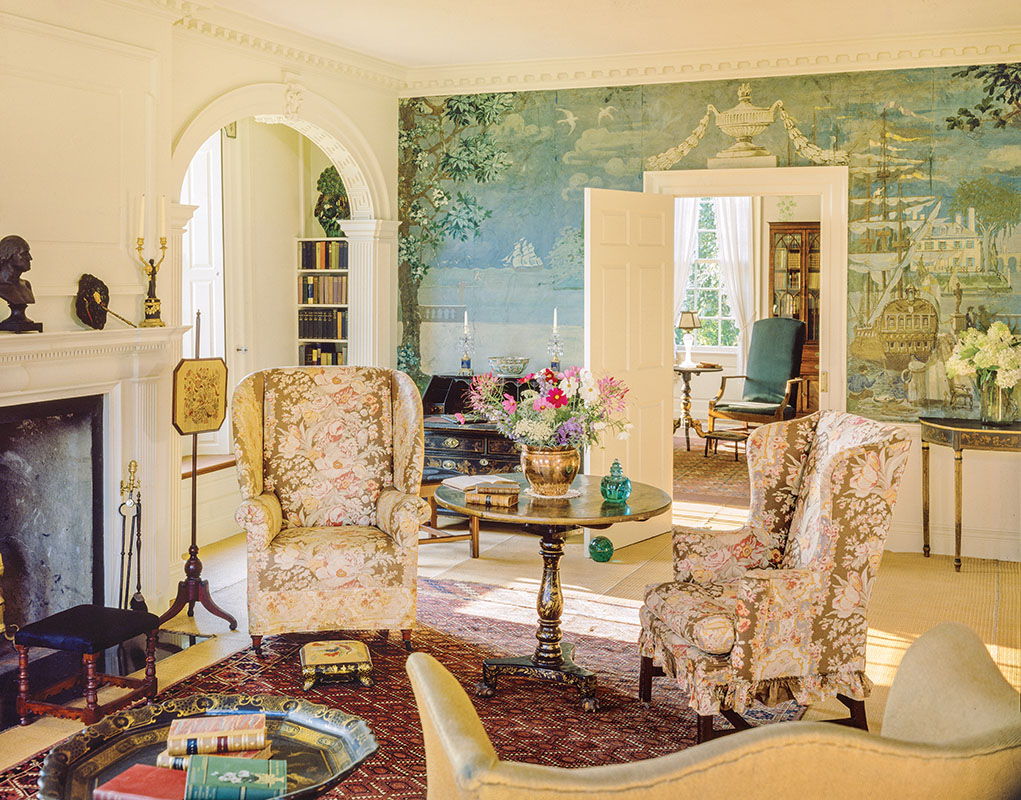 Artist George Porter Fernald's dining-room mural depicts Italian gardens and the Mediterranean shoreline, a playful reference to the garden and river outside this house in Maine. Woven straw matting was a common treatment for floors in Colonial Revival summer houses.