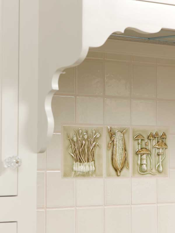 Hand-painted art tiles are from Pratt and Larson.