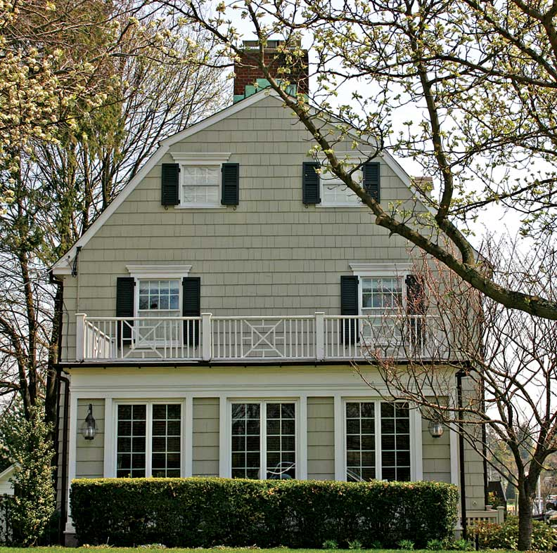 """After the book and movie came out, new owners of the """"Amityville Horror"""" house replaced the arched windows in the gable of the Dutch Colonial to make it less recognizable."""