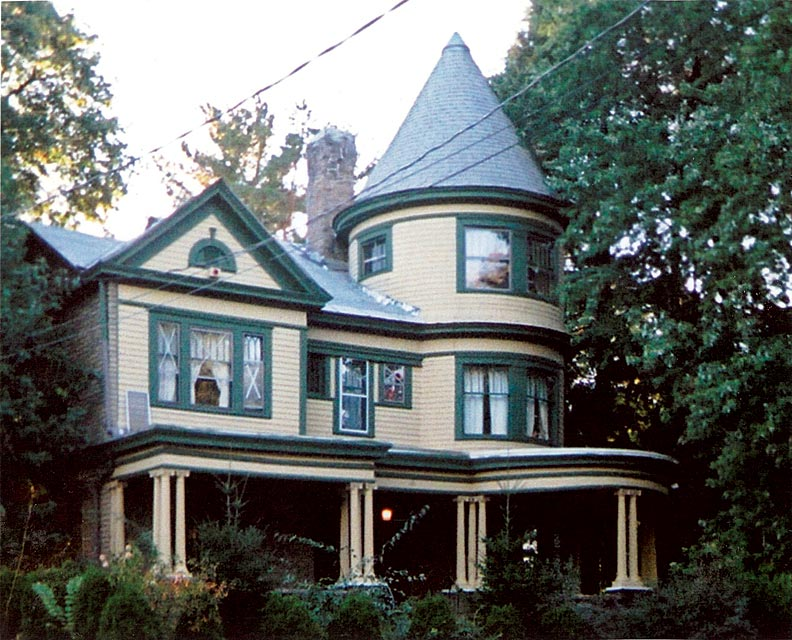 In this photo Leslie Hart-Davidson took of her empty house, a shadowy figure appears to hover in the center of the left bank of second-floor windows.