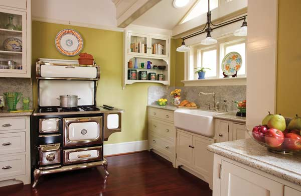 Heartland's 'classic' gas stove is crowned by an Italian platter and flanked by cabinets on a butler's pantry. The sink wall is simple, old fashioned, and flooded with light. Photo: Philip Clayton-Thompson.