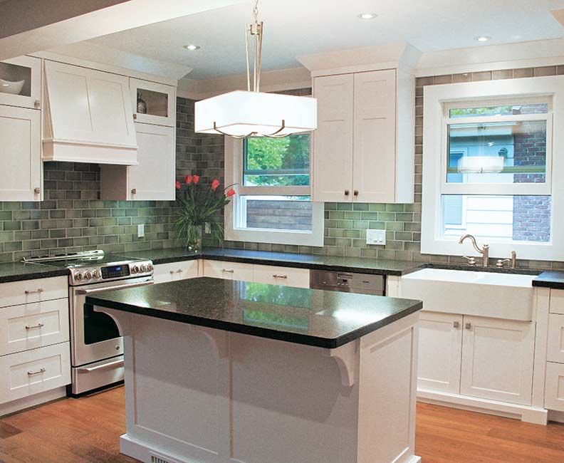 A green tile backsplash offers a Craftsman feel.