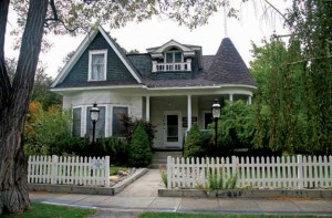 The picturesque Queen Anne style survived into the 20th century in Carson City, exemplified by the Herman Springmeyer house, circa 1908, with its fanciful conical porch roof.