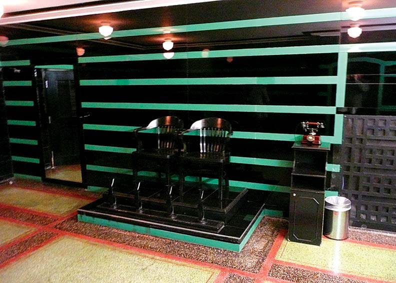The Art Deco men's room in the basement boasts its original shoeshine stand.