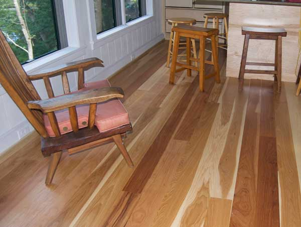 Hickory displays striking contrasts between the heartwood and lighter sapwood; this floor is from A.E. Sampson.