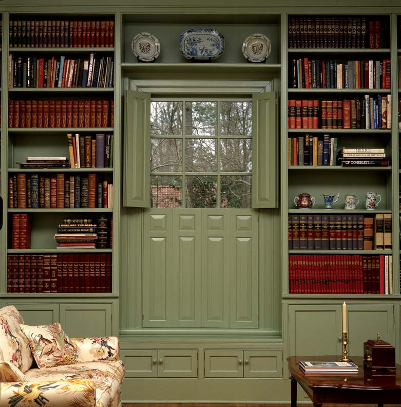 Bifold raised-panel shutters not only make a handsome frame for the window, as in this Georgian-era library, but they also help keep drafts at bay.