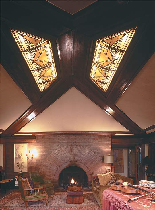 Frank Lloyd Wright's masterly hand shines in his 1902 Heurtley House in Oak Park, Illinois. In the living room, a dramatic stained-glass skylight complements a brick fireplace that is unadorned except for its massive, Sullivanesque arched opening. Paul Rocheleau photo