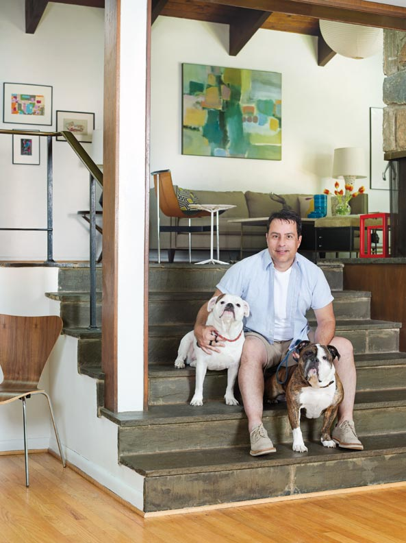 Homeowner George Marrone with English bulldogs Sasha and Sophie.