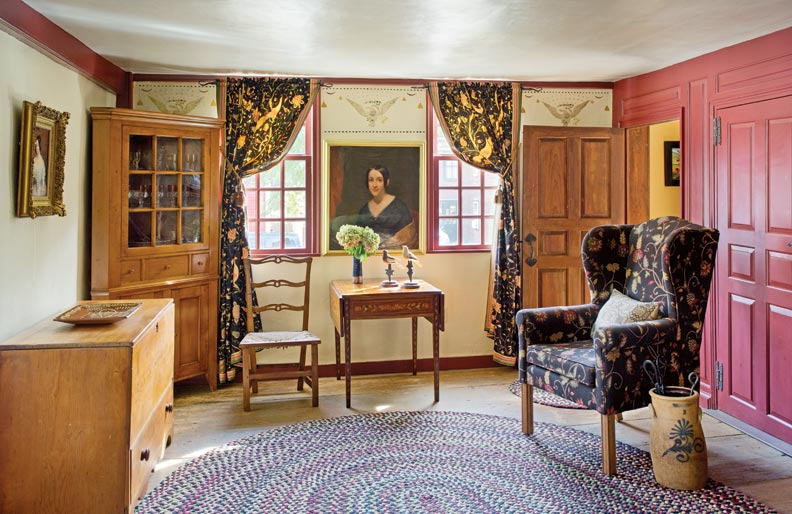 Homeowner Kathy Bruce painted the stenciled decoration in the parlor, taken from Rufus Porter designs of the early 18th century. Reproductions by Angel House Designs of Brookfield, Massachusetts, furnish the room.