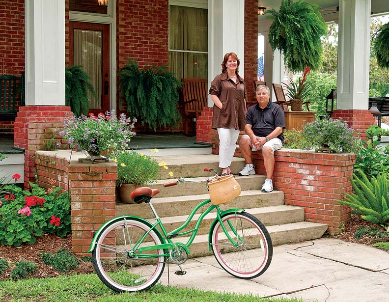 Homeowners Theresa and Jim Barnatt on their rebuilt front porch.