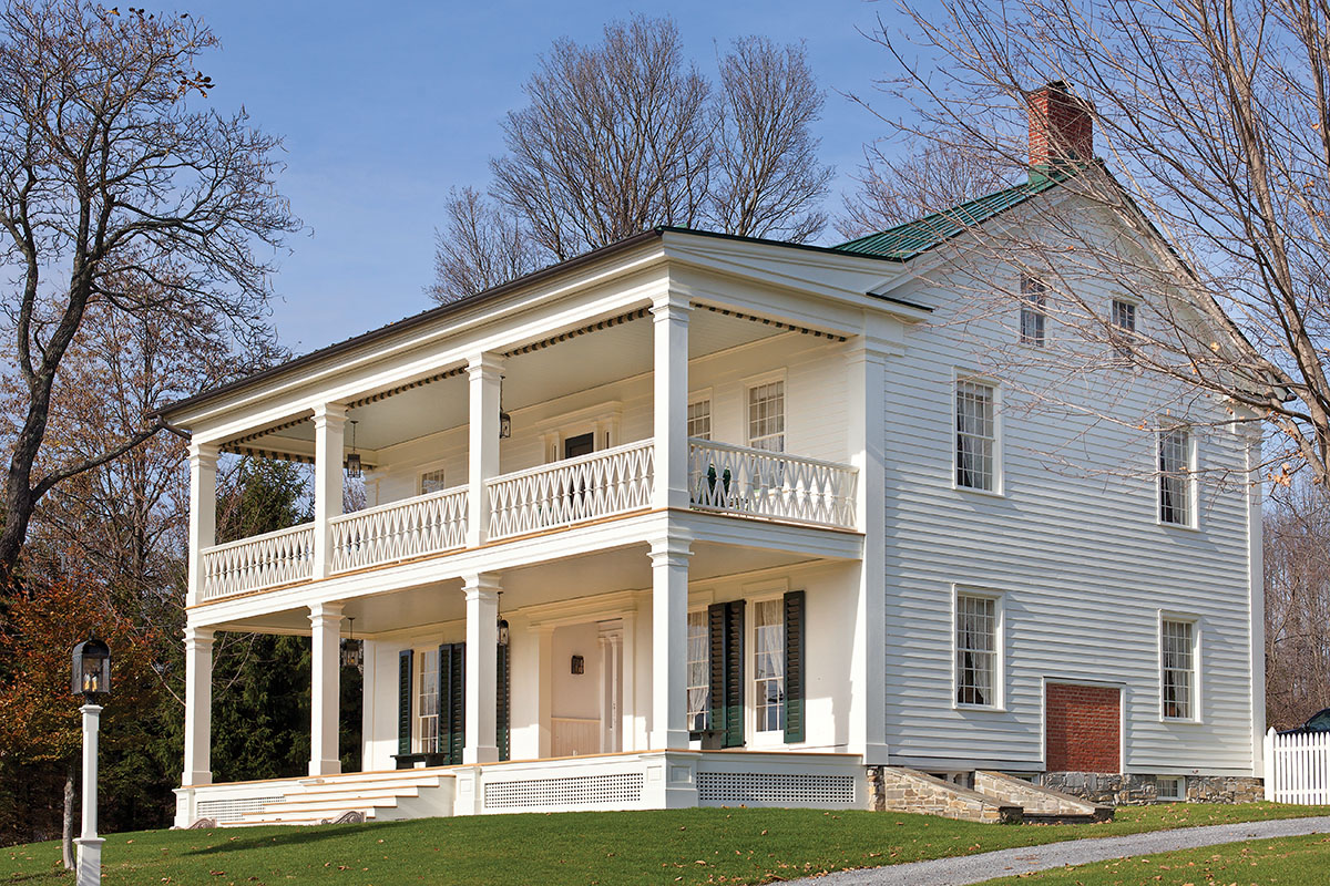 """""""HOTEL SCHOHARIE"""" A period portrait of this building now at Colonial Williamsburg alerted the owners that it once had a two-storey porch; evidence of the rafters provided corroboration. They rebuilt it."""