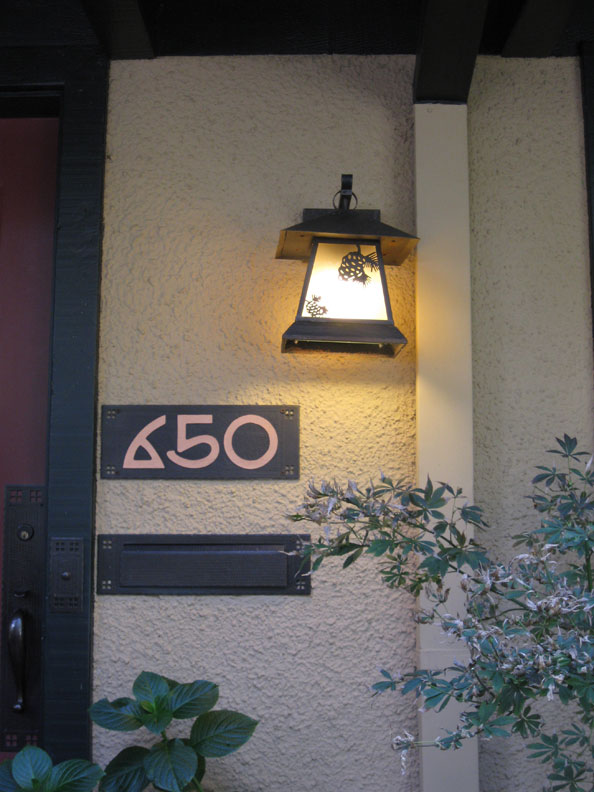 Arts & Crafts-style address numbers add instant style to a bungalow entryway.