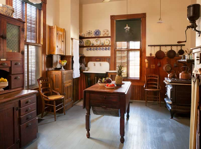 If your object is to re-create a true 19th-century period kitchen, the challenge is to not get cutesy with the details. It should be a utilitarian space.