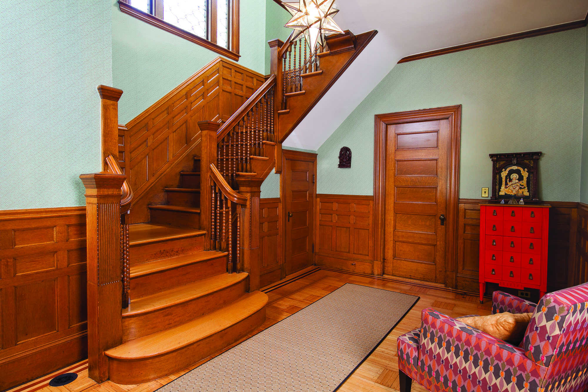 The front stair hall retains its original Queen Anne character.