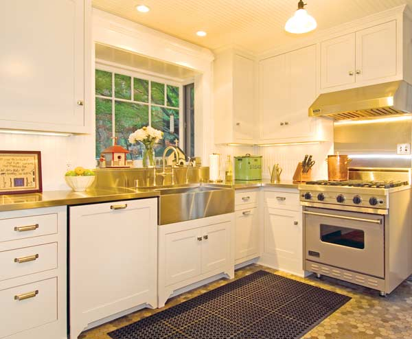 "In a Pasadena buglalow, the re-creation of a 1920s ""service"" kitchen with painted cabinets cost about $39,000. Photo: Chris Considine."