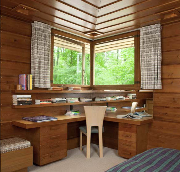 In bungalows, a built-in desk might take the place of the fireplace or fold out from a colonnade; Frank Lloyd Wright commonly incorporated built-in desks and vanities into bedroom walls in his Usonian houses.