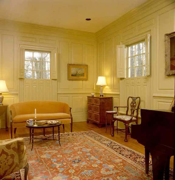 In high-style Georgian homes, raised-panel shutters often reflected floor-to-ceiling room paneling, like these reproductions from Americana.
