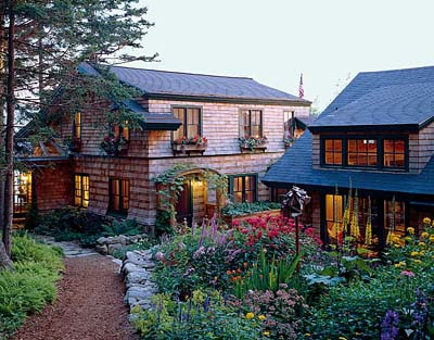 In the design of this rustic coastal Maine Shingle-style house, architectural history is a part of that context.