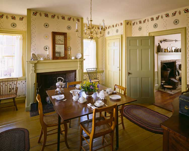 In the dining room of an early house in Maine, exuberant folk stenciling displays a wealth of patterns inspired by nature. Photo: Brian Vanden Brink