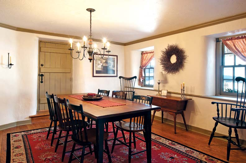 """In the dining room, plasterer Jack Thompson maintained the traditional curves around the windows and doors, called """"witches' corners."""""""