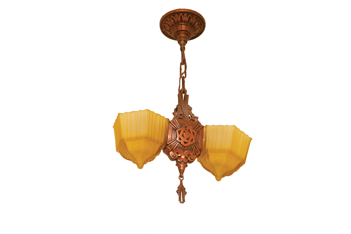 In the hallway, a 1930s American Depression-era ornamental ceiling fixture has dual amber pressed-glass shades.