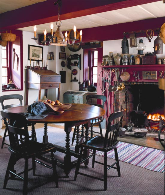 In the kitchen, an 18th-century English swing-leg table is surrounded by Pennsylvania plank-seat chairs. The crock nearest the center box on the mantel was made by a member of the Van Deusen family.