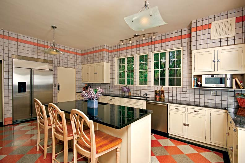 In the kitchen, appliances were returned to their original locations, new linoleum flooring was patterned on an original sample in the adjacent maid's hall, and the salmon Faience wall tiles were stripped of a beige paint job.