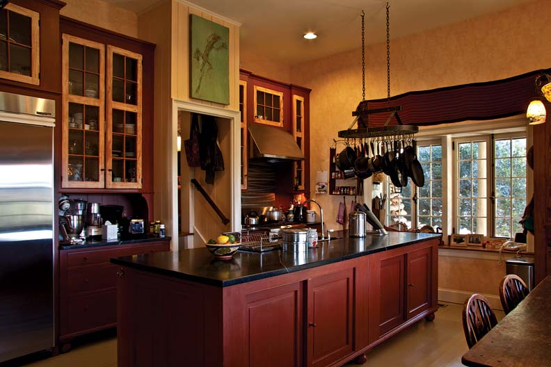 In the kitchen, Charles used materials from the 1920s lean-to garage to craft custom cabinets.