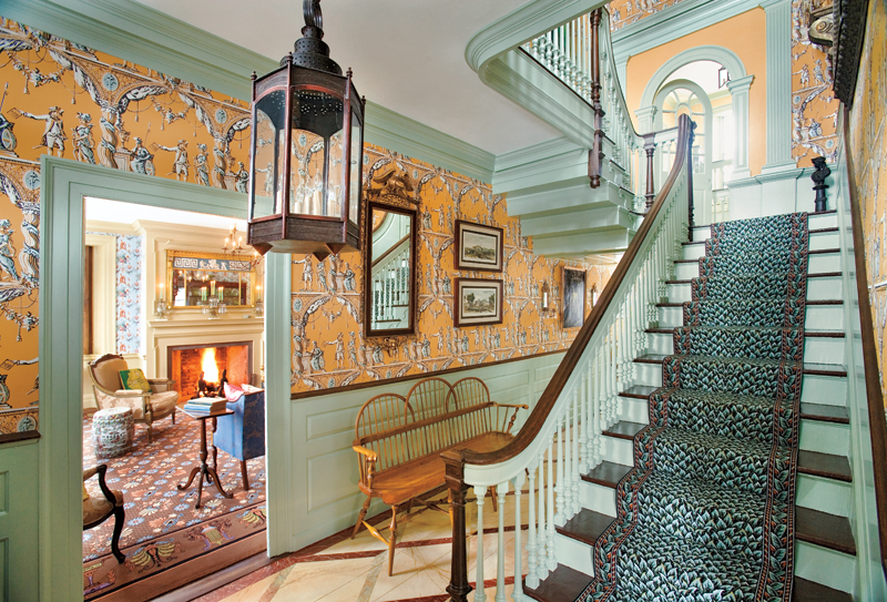 In the main hall, wood floors are marbleized, the block print paper pattern dates to 1776, and the ca. 1880 Wilton stair carpet is a reproduction.