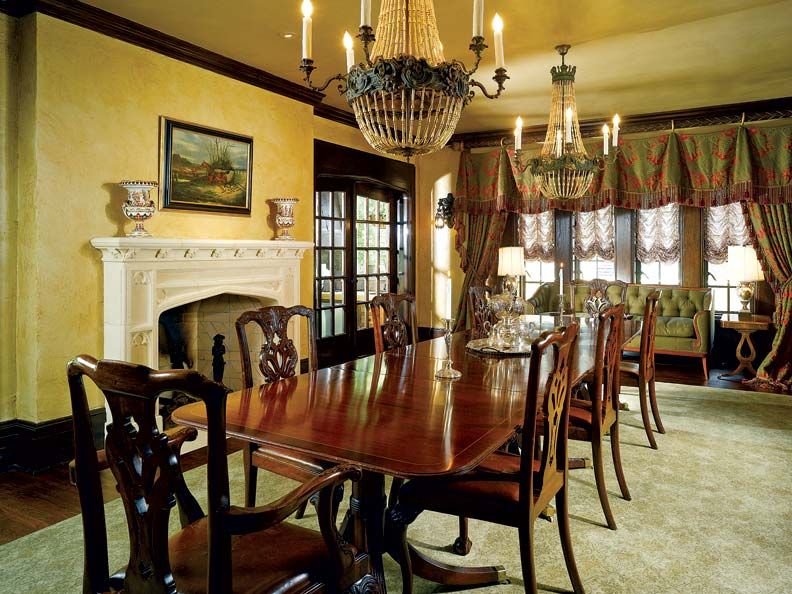 In the newly expanded dining room, French doors flanking the fireplace lead out to the covered terrace. Malcolm and Kelley scrapped plans for ornamental plasterwork on the ceiling, instead going with a subtle glaze that gives it a slight metallic sheen.