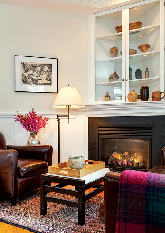 In the sitting-room corner of the new kitchen, a display cabinet was built in over the gas fireplace; two old fireplaces were refitted with gas inserts.
