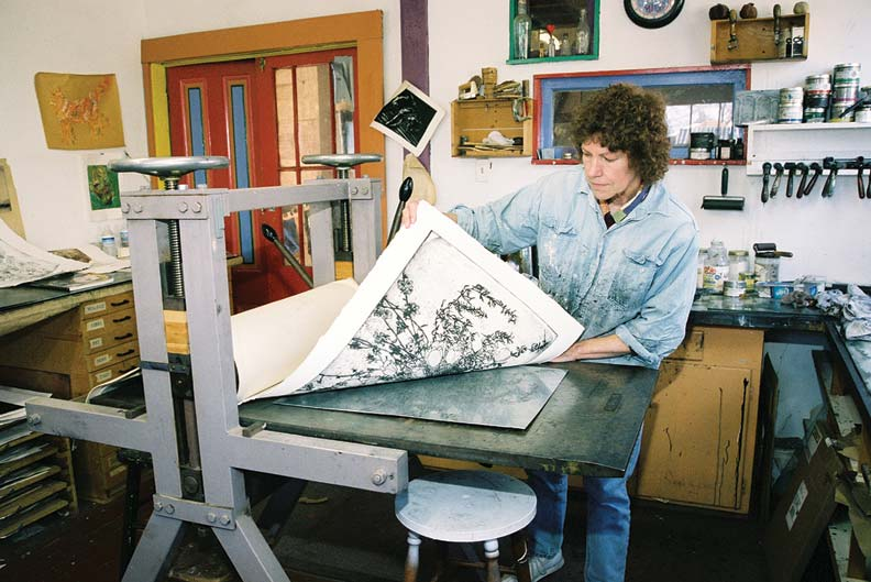 In the studio, artistic juices flow freely, as attested by this printmaker honing her craft.