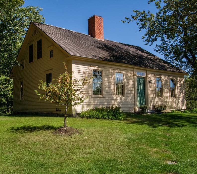 In the tradition of old Maine houses, the addition sits behind the 1760 Cape.