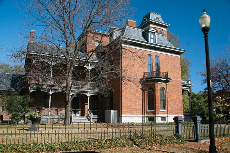 A prominent arcaded, two-story porch distinguishes the 1865 Morris-Butler House.