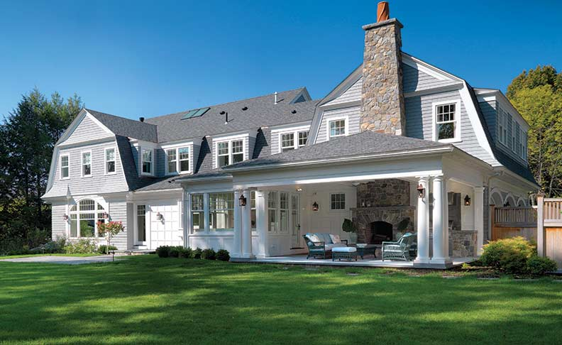 A three-season screened porch and open porch with hearth offer the best of all worlds when it comes to outdoor enjoyment.