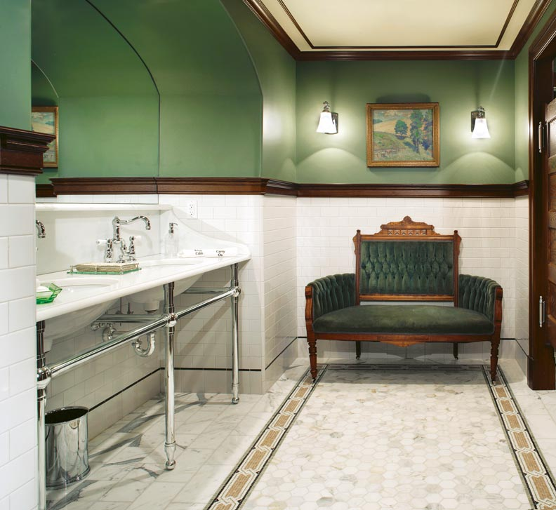 A Victorian settee with its original green upholstery lends a bit of history and contributes to the hotel mood. A mosaic-tile floor (with a subtle Celtic design) adds to the commercial look.