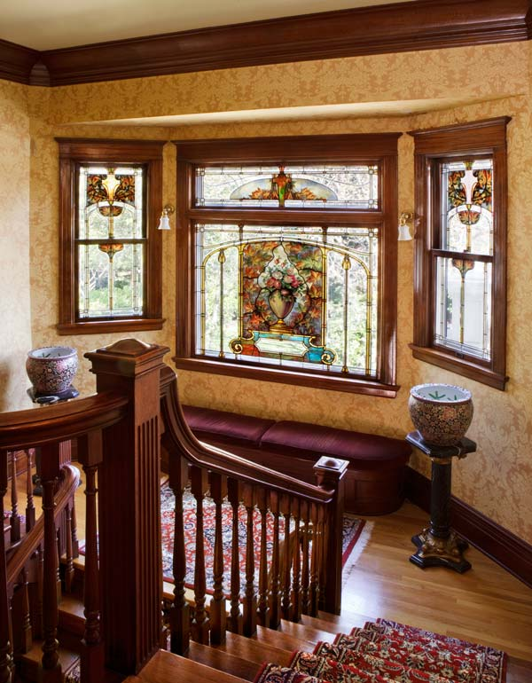 It is believed that Mrs. Barnes lobbied for the painted art glass, depicting roses and autumn leaves, on the landing.