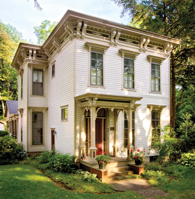 Painted in the warm earth tones typical of the period, this Michigan Italianate is small, but still bursting with ornamentation.