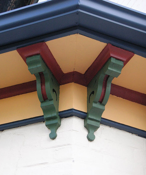 Five of the house's seven colors are visible at the soffit.