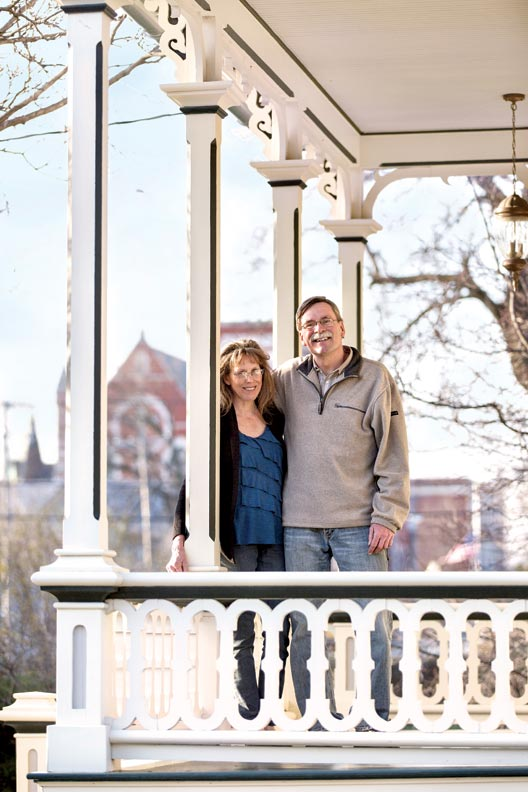 Homeowners Pat and Dan Miller on the re-created porch.