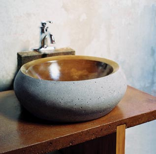This concrete vessel sink and warmly colored countertop are by J. Aaron Cast Stone.